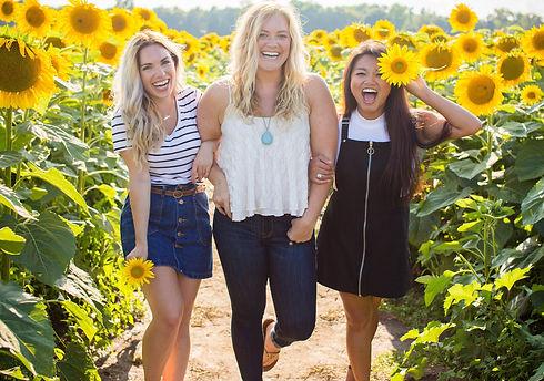 three%20women%20standing%20between%20sunflowers_edited.jpg