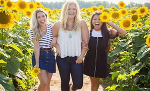 three%20women%20standing%20between%20sunflowers_edited.jpg