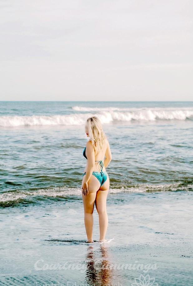 blue bikini on beach looking over should