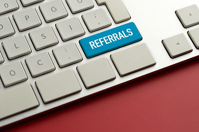Computer key showing the word REFERRALS.