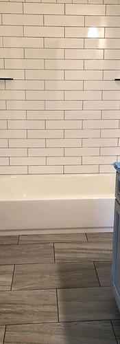 Tile Flooring with Marble Walls