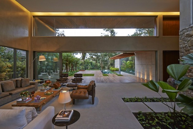 Spacious-Open-Living-Space-Applied-in-with-Wooden-Coffee-Table-with-White-Sofa-Set-Design-Finished-with-Glass-Material-630x420