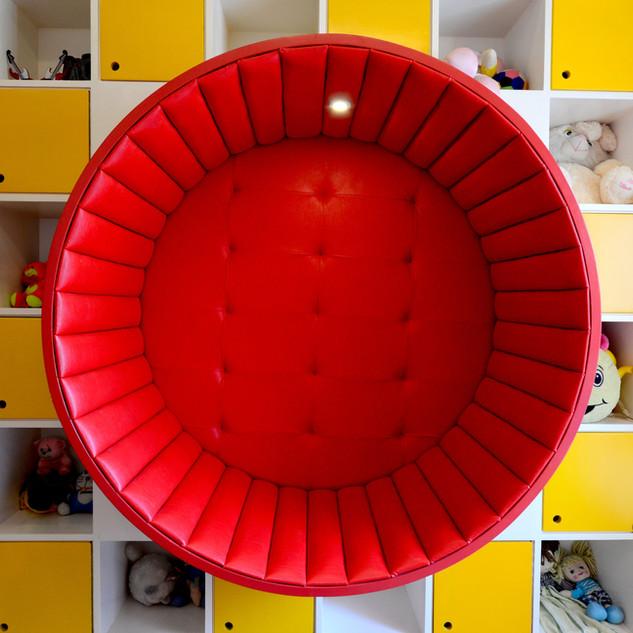 A large checkerboard pattern juxtaposing a circular seat