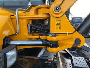 Montage van een Autol automatische vetsmering op een JCB Hydradig