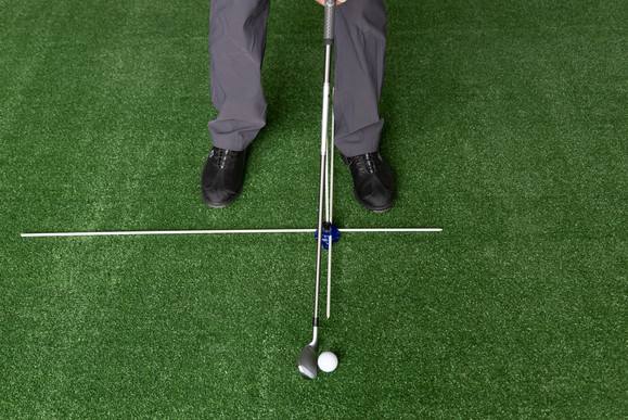 Using the short 18 inch Guide Rod to check Shaft lean and Hand Position with ball placed between the feet not off toes