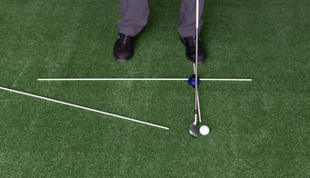 Using the short Guide Rod to set ball position in line with the Toes and the longer Alignment Guide Rod for the downswing path