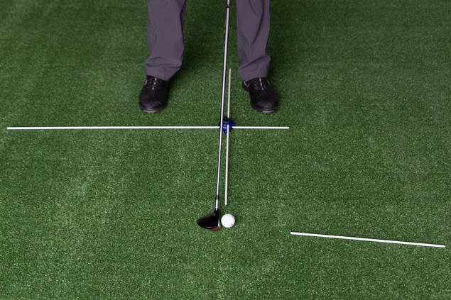 Setting the short Alignment Guide Rod past the ball to set a Follow-Through Swing Path
