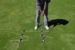 Using 5 Golf Pucks to set  Golf Swing Paths and Alignment to the Ball and Target