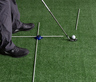 This is a photo showing the Down-The-Line View of the previous Face-On View of a Guide Rod placed past the ball, for a follow-through swing path