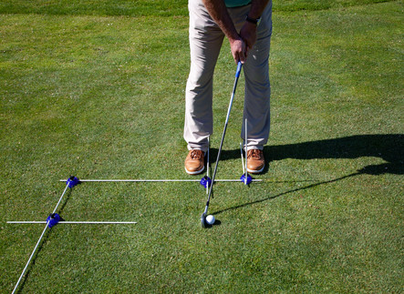 Pitch-Chip with ball back in stance and hands ahead of ball