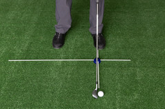 Using the short 18 inch Alignment Guid Rod to set ball forward in Stance off Toes