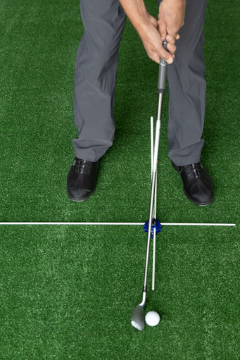 Using a Vertical Alignment Guide Rod to set hands ahead of Ball