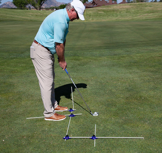 Setup for chipping with ball back in stance with Target and Vertical Alignment rod