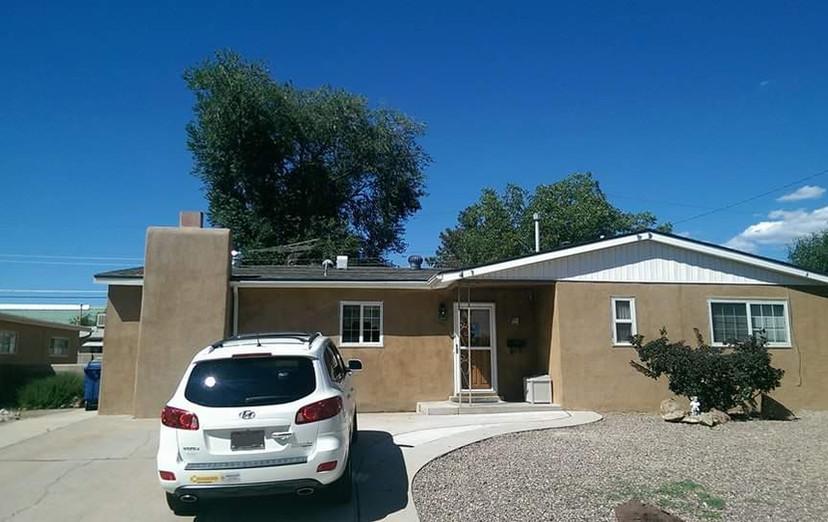 New shingle roof and stucco