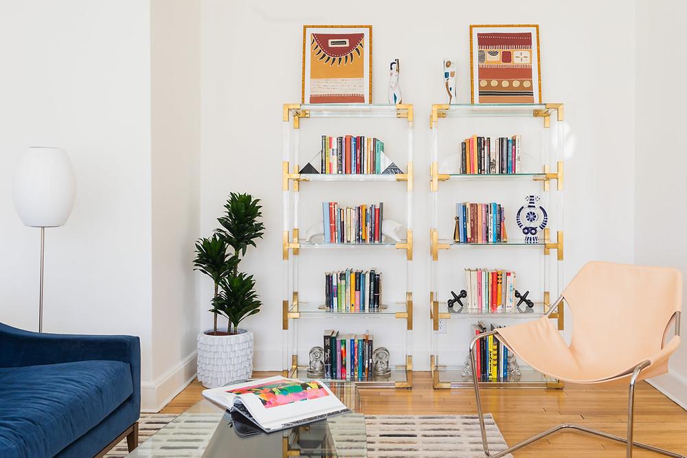 Cambridge Collector Living Room, Interior Design, Vintage Bookends, Lucite Shelves, Unique Collectibles, Artwork, Eclectic