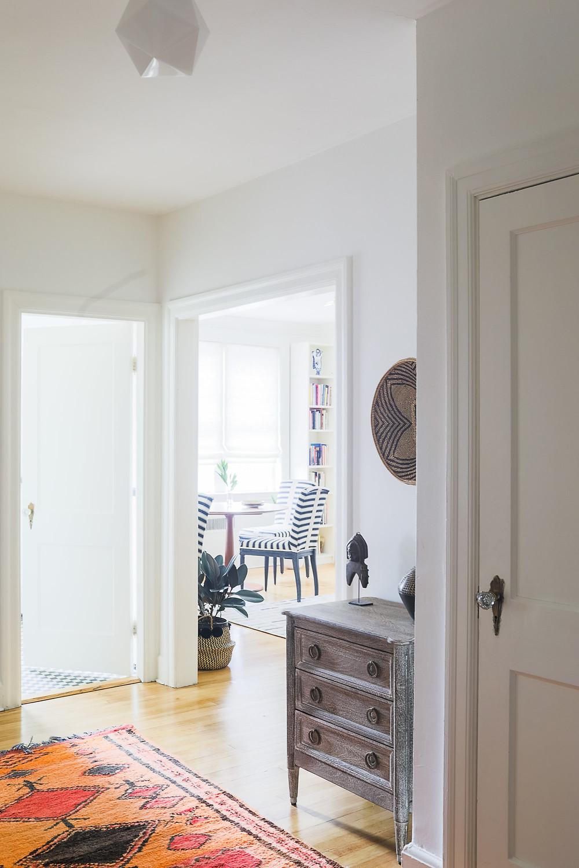 Cambridge Collector Living Room, Interior Design, Entryway, Moroccan Rug, African Accessories, Unique Collectibles, Artwork, Eclectic