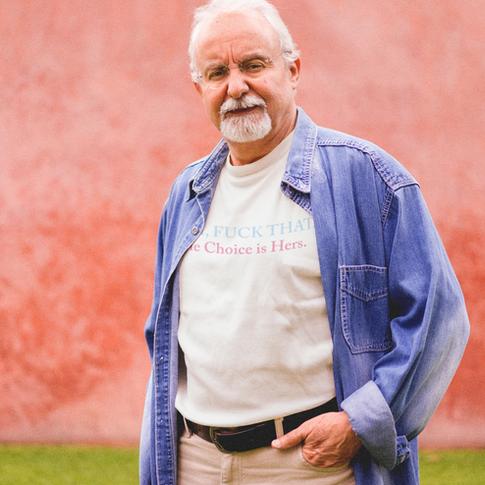 elder-man-wearing-a-t-shirt-with-a-denim