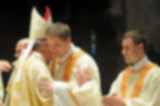 Bishop Embracing a Deacon. Gibraltar Catholic Youth.