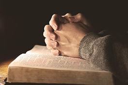 Open Bible Praying hands. Gibraltar Catholic Youth.