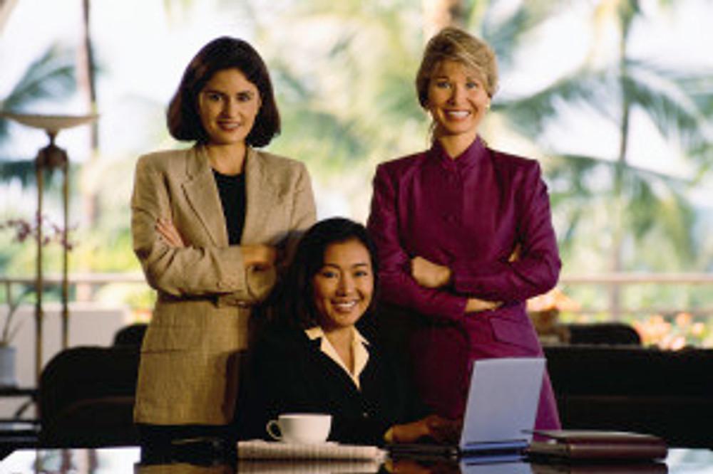 Three Smiling Businesswomen