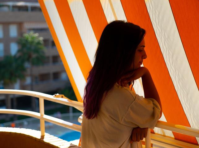 Marina in front of shades on balcony_.jp