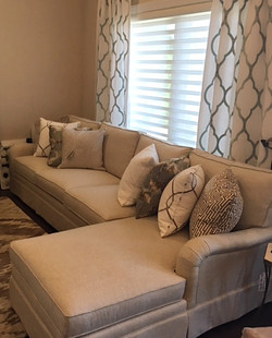 Sectional, pillows, drapery, rug