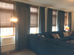 Pleated drapery & woven wood shades