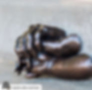 picture of koa's hands with his parents in a bronze sculpture