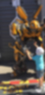 cofounders son at 3 years old meeting his heo Bumblebee from the transformers at universal studios hollywood