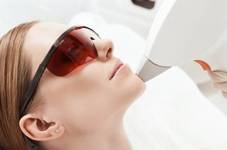 Laser therapy used by Chicago derm reduces signs of aging by treating sun damage & sunspots