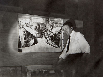 Rivera with photo of destroyed mural.jpg