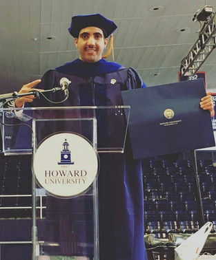 Receiving doctorate from Howard University