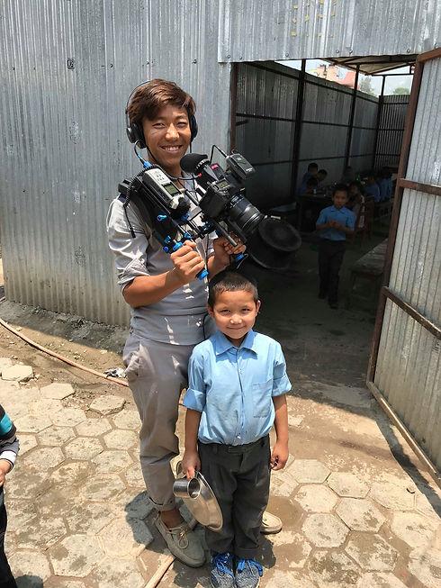 Nima as film school student filming Snow