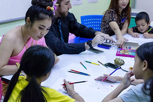Children studying with American and Thai teachers