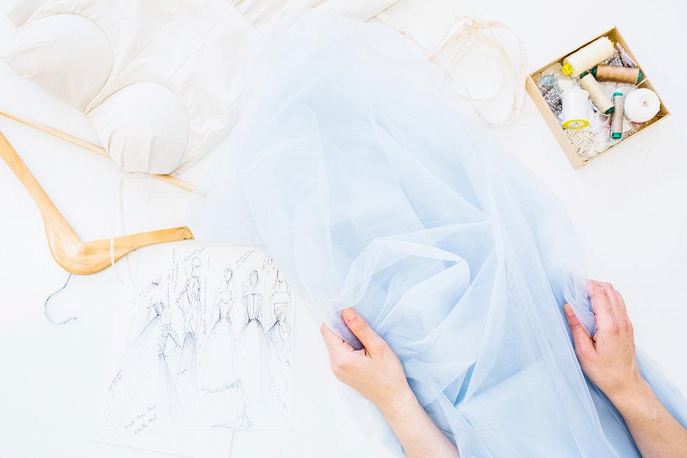 designer-s-hand-with-textile-workbench.j