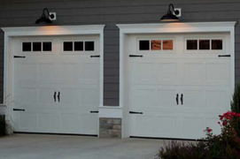 9x7 polar white recessed short panel with 3 pane carriage house windows with decorative handles and hinges