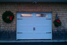 9x7 polar white ribbed short panel with 3 pane arched carriage house windows and decorative handles and hinges