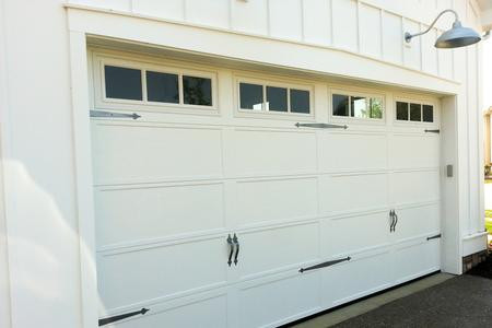 16x8 polar white recessed long panel with 3 pane carriage house windows with 2 sets of decorative handles and hinges