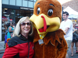 Linda with a Turkey at Get Downtown