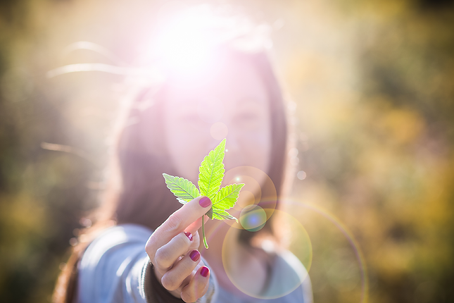 girl with cannabis leaf
