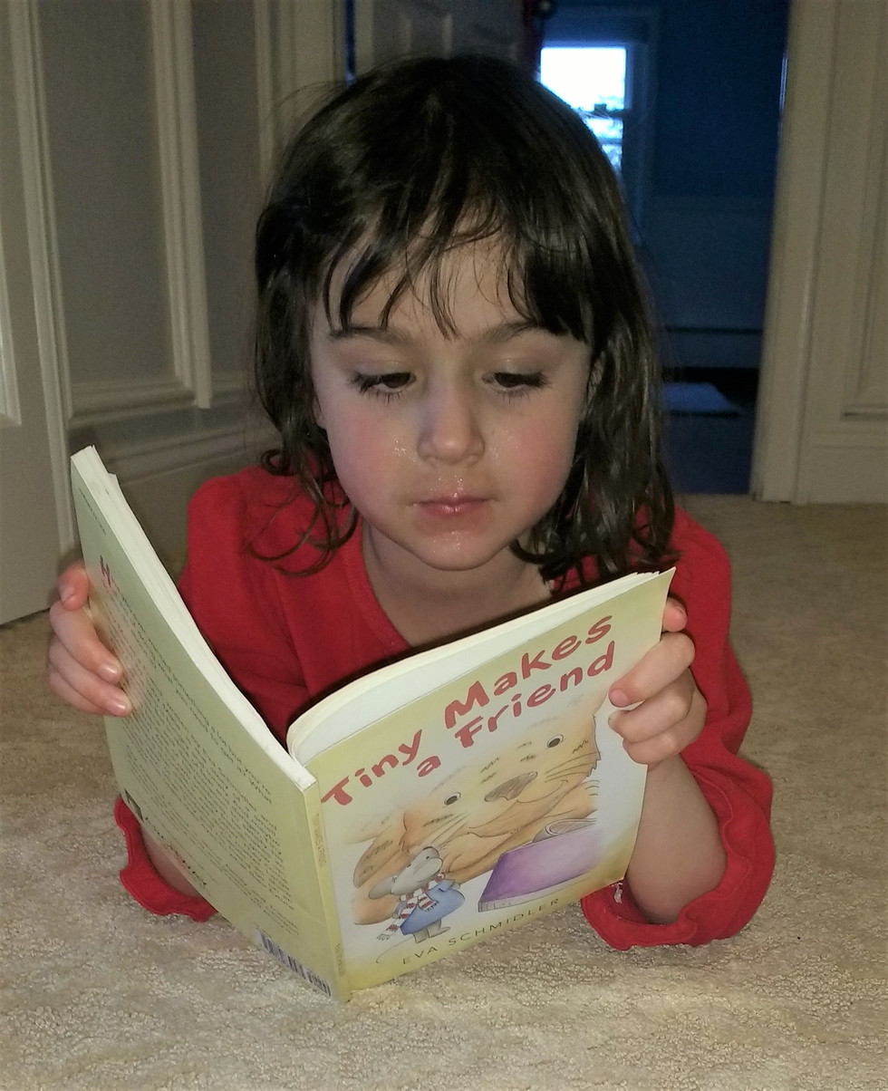 Young Reader loves Tiny Book