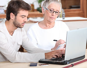 mature lady getting computer assistance.