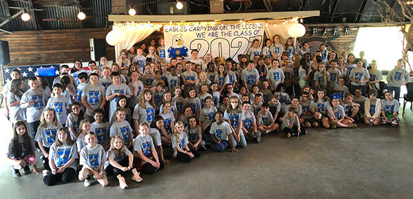 4th graders with their class of 2027 banner