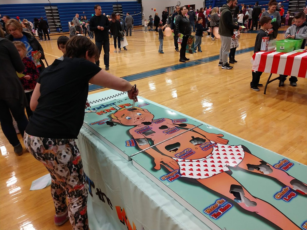 Student playing a game at the HESPA fair.