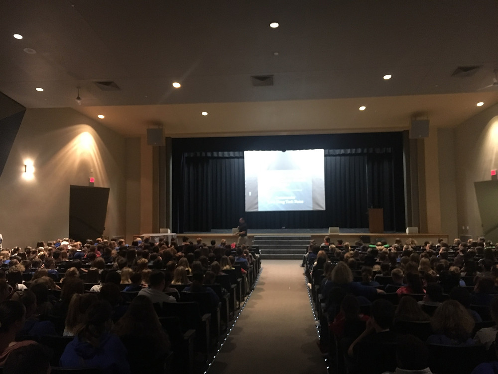 Students in the auditorium listening to a presenter.