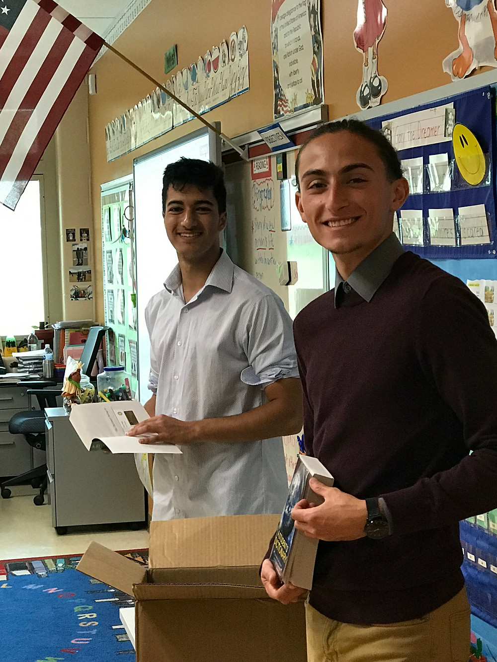 Two rotary students in a classroom at the elementary school
