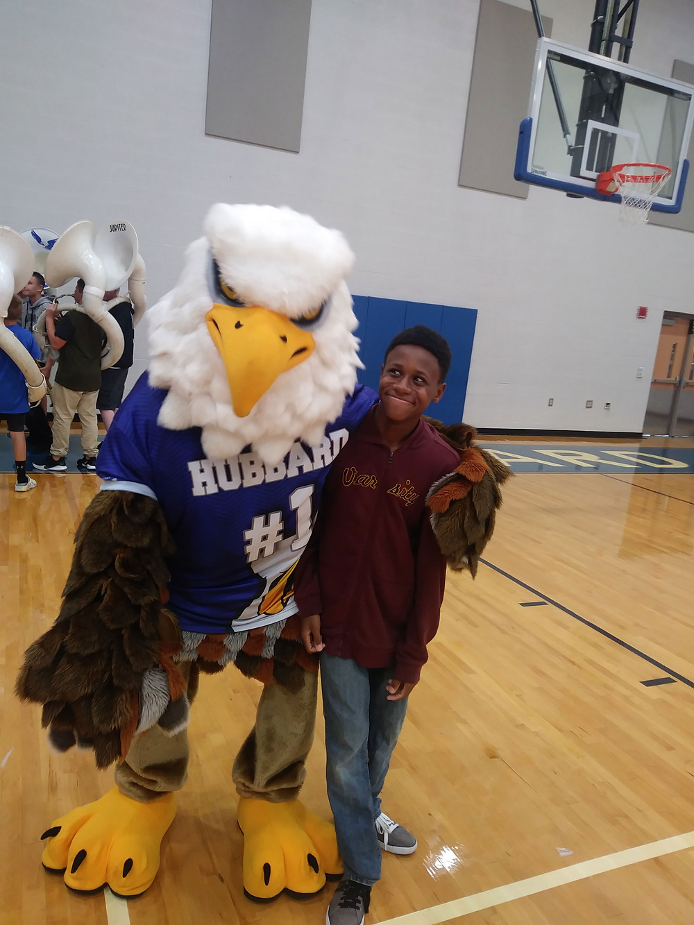 Hubbard Student posing with the Hubbard Eagle Mascot