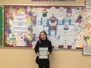 Hubbard Middle School student with poem award