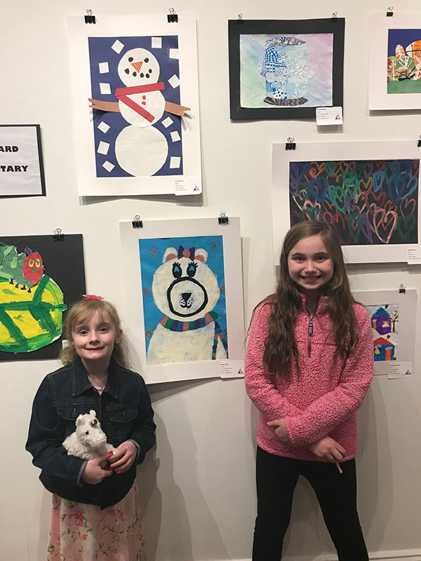 ES Students standing next to art at the Trumbull Art Gallery