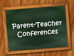 "A chalk board with the words ""parent-teach conferences"" writen on it."